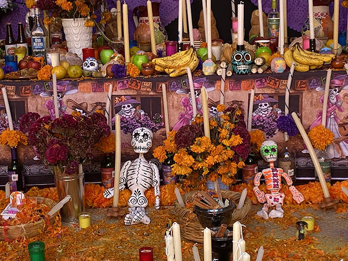 altar day of dead marigold flowers skeleton offerings