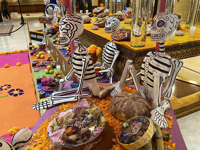 bread of the dead, paper skeleton statues mexican