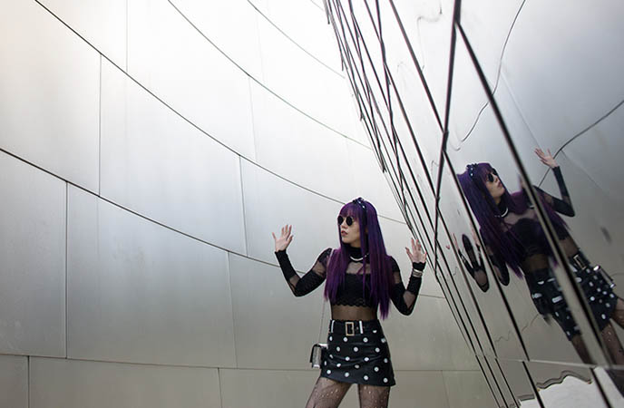 downtown la disney music hall curving metal reflective walls outfit photos