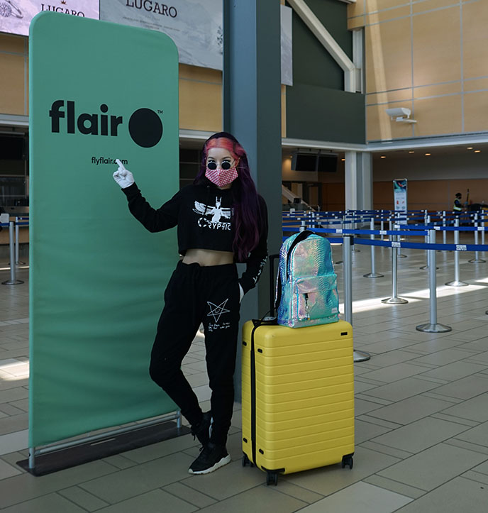 yellow away luggage, flair airlines travel influencer instagrammer canada