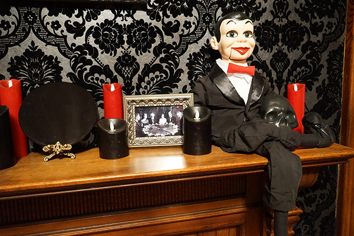 horror ventriloquist dummy red bow tie