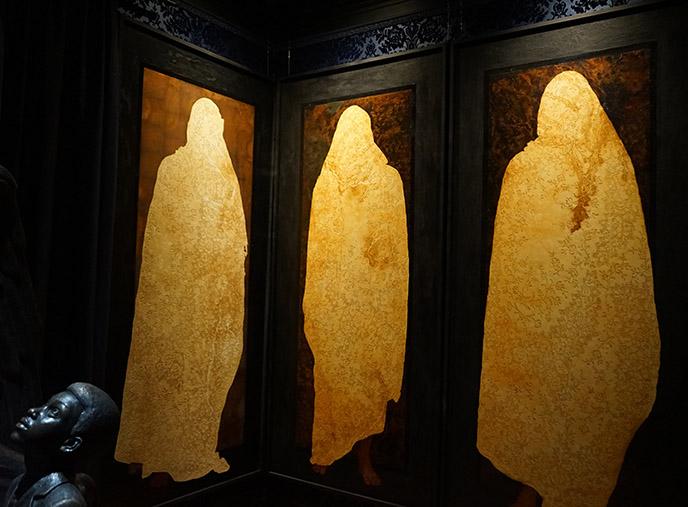 salem art gallery ghostly figures panels satanic temple exhibit