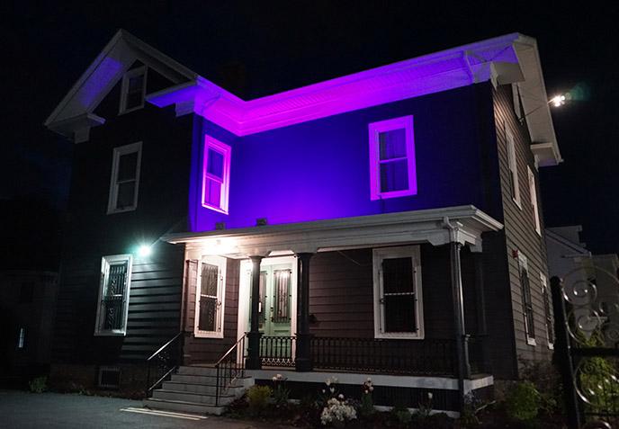 the satanic temple headquarters salem at night purple glowing lights