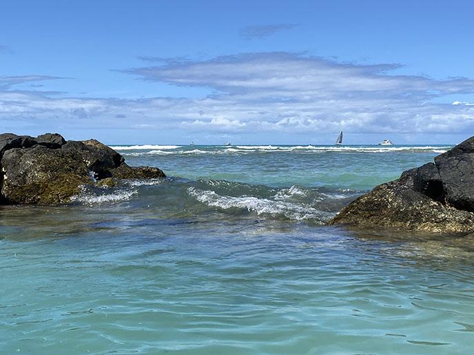 honolulu waikiki beach rocks ocean